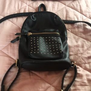 Small back pack. Black and gold